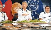 Samoa Police Commissioner along with two other officers in front of guns confiscated.