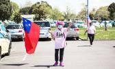 Woman with mask waving Samoan flag