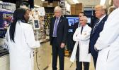Dr. Kizzmekia Corbett, left, senior research fellow and scientific lead for coronavirus vaccines and immunopathogenesis team in the Viral Pathogenesis Laboratory, talks with President Donald Trump