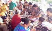 Senior Citizens getting a blood pressure check