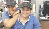 Two smiling McDonald's servers