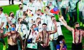 Shirtless Samoan male athletes at Tokyo Olympic Closing Ceremony