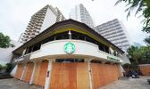 A Waikiki Starbucks coffee shop near Kapahulu Avenue with windows boarded up
