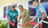 First Lady Cynthia Moliga (middle) cutting the ribbon last Friday to officially open the Pacific Sleep Care clinic, which treats sleep apnea. She is assisted by Health director Motusa Tuilema Nua (far left) and Pacific Sleep Care general manager Ferdie Salvador.[photo: AF]