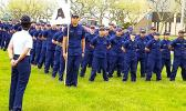 In this photo from the U.S. Coast Guard Family Facebook page. Alaimaleata is leading the whole unit (front) holding the flag.  [courtesy photo]