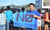 Posing for the Samoa News camera, one of the many South Pacific Academy students who participated in the school's wave yesterday morning, reminding the public of the negative impact of bullying. [Photo: JL]