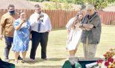 Aaron Tui, his wife Catalina Salafai Markowitz Tui, Abraham Markowitz and Winnie Markowitz watch as their father, Barry Markowitz, shovel in hand, prepares to bury his wife, their mother.