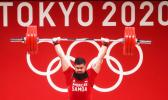 Tanumafili Malietoa Jungblut in front of Olympic logo lifting