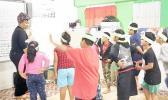 Ms. Faaletaua Saili and Lupelele Elementary students