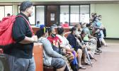 Tax filers wait for their turn at the Tax Office