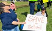 Teachers and demonstrators last week hold signs at SPA