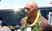 The Rock speaks to reporters during his visit to TMT protest