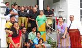 """Gov. Lolo M.  Moliga and First Lady Cynthia Moliga with members of the Tongan community who brought food for the first family to the Governor's Mansion on Sunday, Jan. 5, 2014. Mafi Sione Lousiale Lotolua Kava said, , """"We, the adopted sons and daughters of American Samoa of Tongan decent felt it an honor and an obligation to provide this """"pola"""" of food to the father and mother of the Territory of American Samoa.""""   [SN file photo]"""