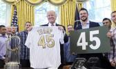 President Donald Trump with Chicago Cubs third baseman Kris Bryant in June. (AP Photo/Susan Walsh, File)