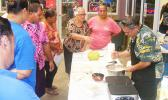 Rep. Su'a Alexander Eli Jennings and customers who showed up at his display table last week at the Fagatogo Market Place to check on gluten free breadfruit flour and two dried breadfruit that can be used to make hash brown.  [photo: FS]