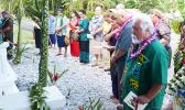 Utu Abe Malae's gravesite surrounded by people who attended his 1 year memorial service