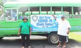 Aiga bus with free rides to vaccine sites banner