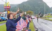 Amata and Veterans wave the U.S. Flag on Veterans Day 2020