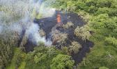 This Saturday, May 12, 2018, image released by the Hawi'i County Fire Department, shows an aerial view of fissure 16, on the Big Island of Hawaii. The fissure is located 500 m northeast of the Puna Geothermal Venture site. Warnings that Hawaii's Kilauea volcano could shoot boulders and ash out of its summit crater are prompting people to rethink their plans to visit the Big Island. But most of the rest of the island is free of volcanic hazards, and local tourism officials are hoping travelers will recognize