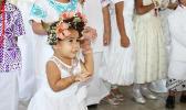 Little girl in her White Sunday best.
